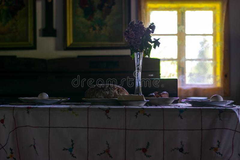Kitchen utensils in the interior of old traditional rural wooden house. stock photos