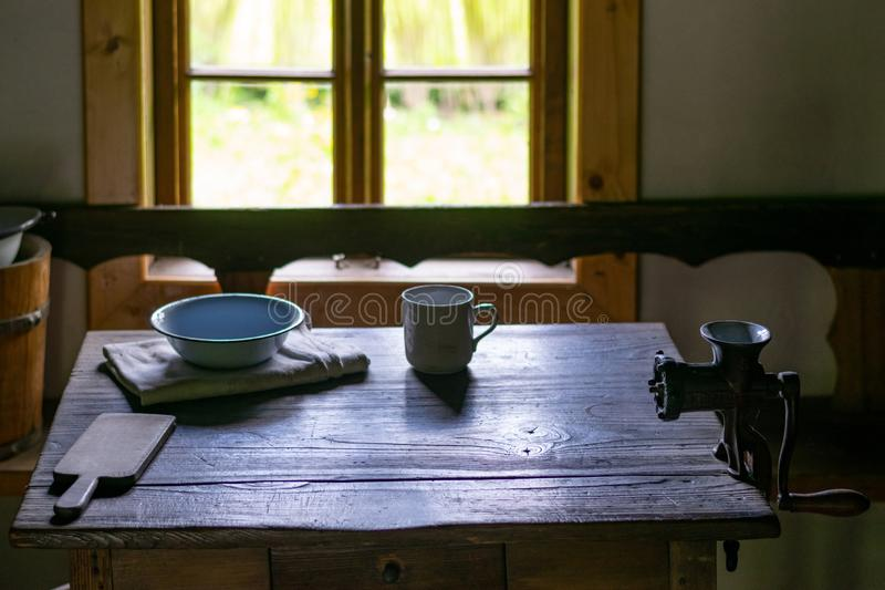 Kitchen utensils in the interior of old traditional rural wooden house. royalty free stock image