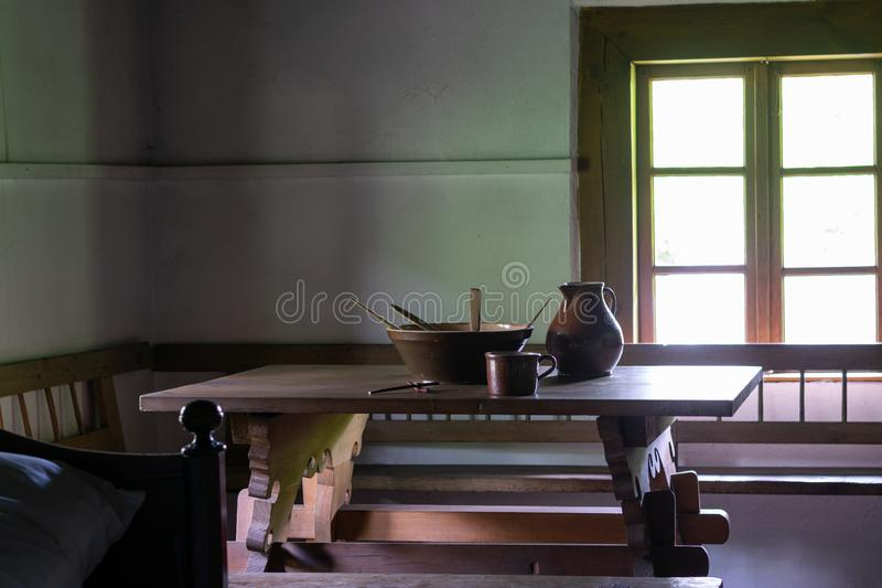Kitchen utensils in the interior of old traditional rural wooden house. stock image