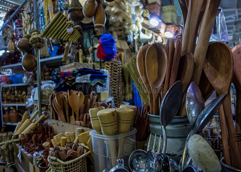 Kitchen utensils made of wood in popular municipal market in Brazil royalty free stock images