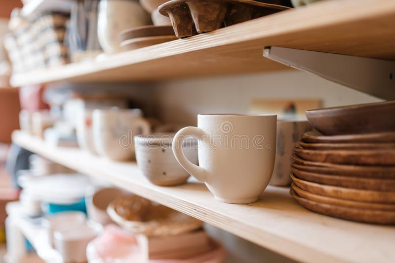 Kitchen utensils on shelf in pottery workshop royalty free stock photo