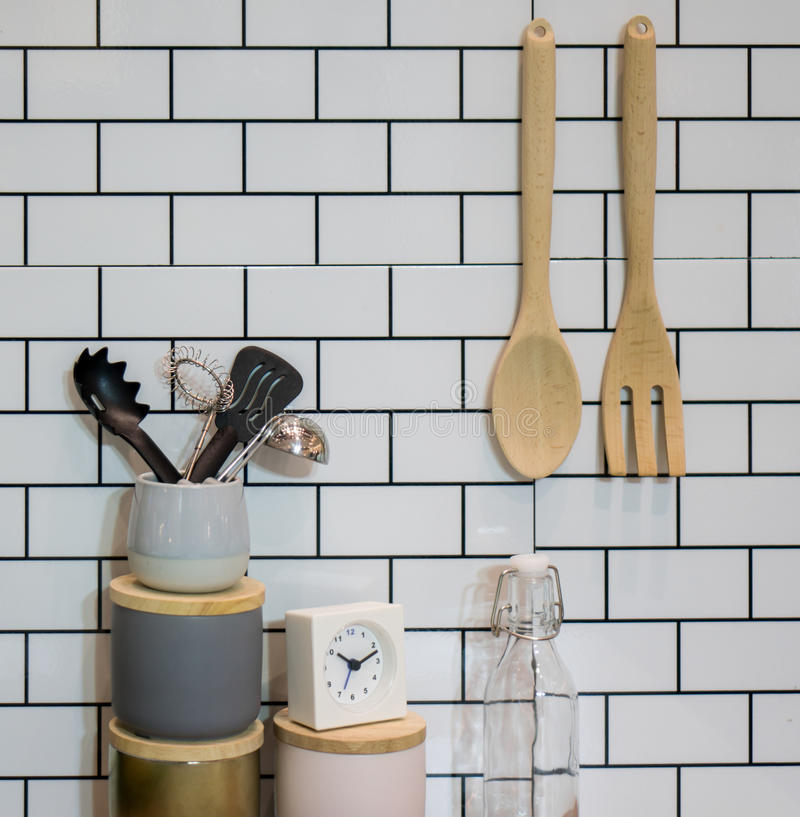 Kitchen utensils and stuff. Against the white brick wall stock photos