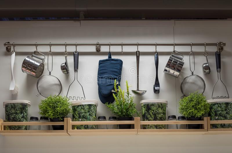 Kitchen utensils on the wall, interior design royalty free stock photo