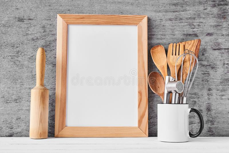 Kitchen utensils and white blank with copy space stock photos