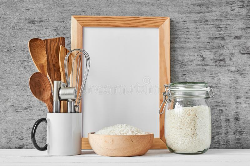 Kitchen utensils and white blank with copy space royalty free stock photos