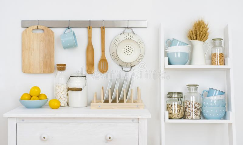 Kitchen wall decorated interior with cabinet and shelf with utensils.  royalty free stock photos