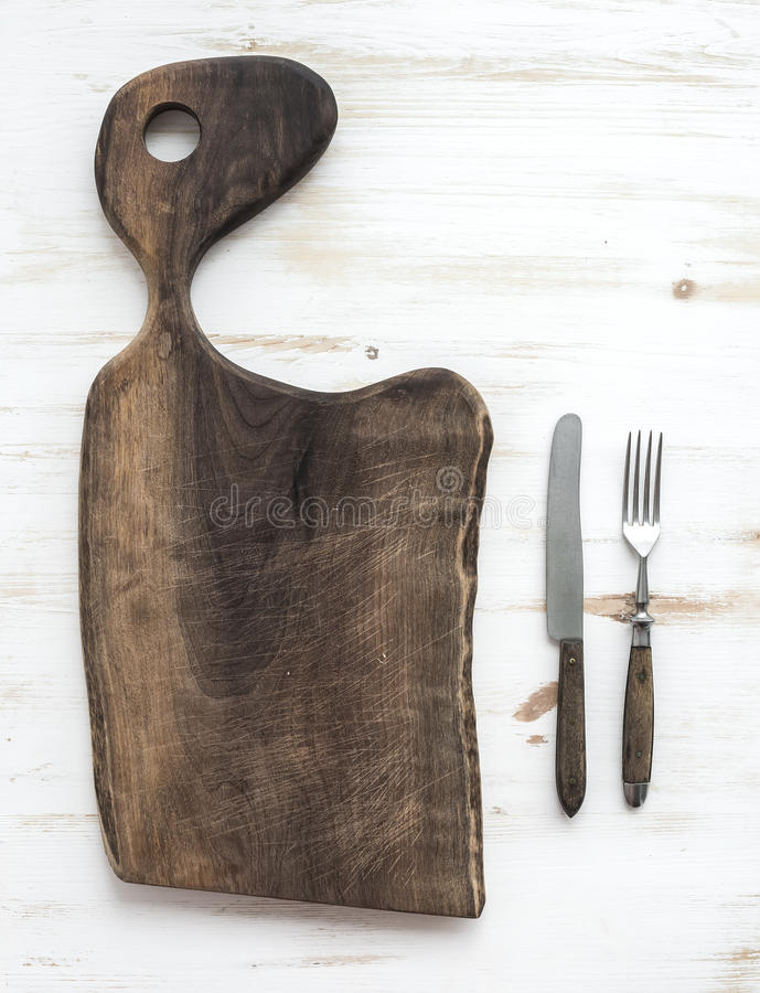 Kitchen-ware set. Old rustic chopping board made royalty free stock photography