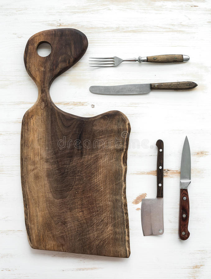 Kitchen-ware set. Old rustic chopping board made royalty free stock photo