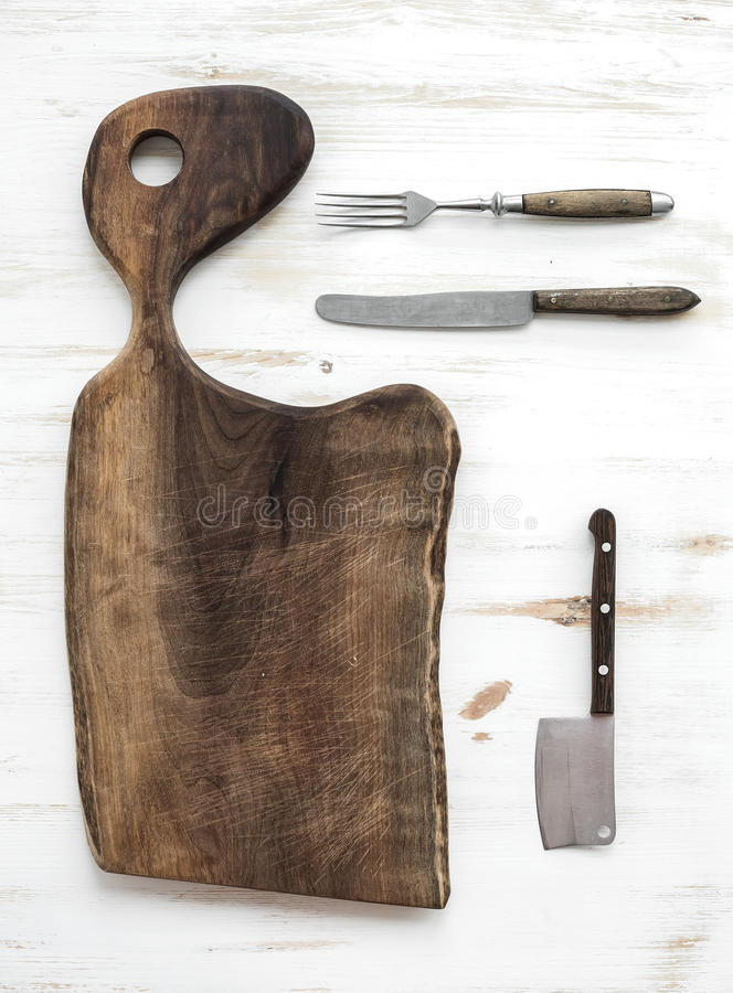Kitchen-ware set. Old rustic chopping board made stock photos