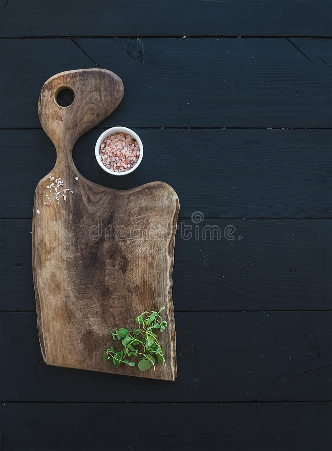 Kitchen-ware set. Old rustic chopping board made royalty free stock image