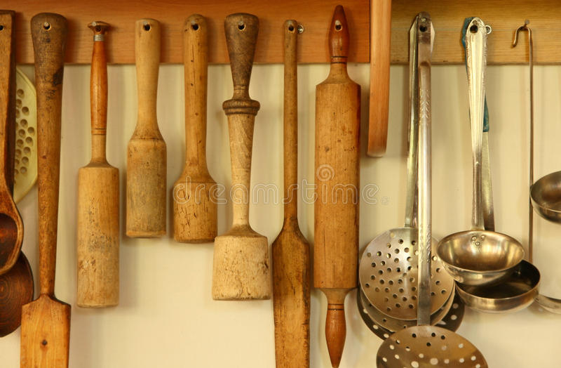 Kitchen ware on the wall. Kitchen ware hanging on the wall taken closeup stock image