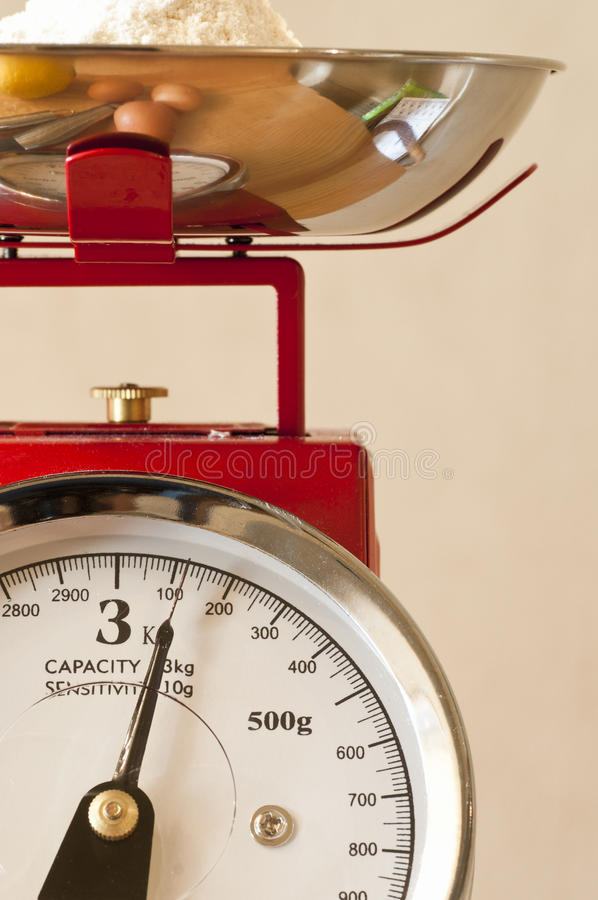 Kitchen weighing scales. Close up view of a set of kitchen scales stock photo