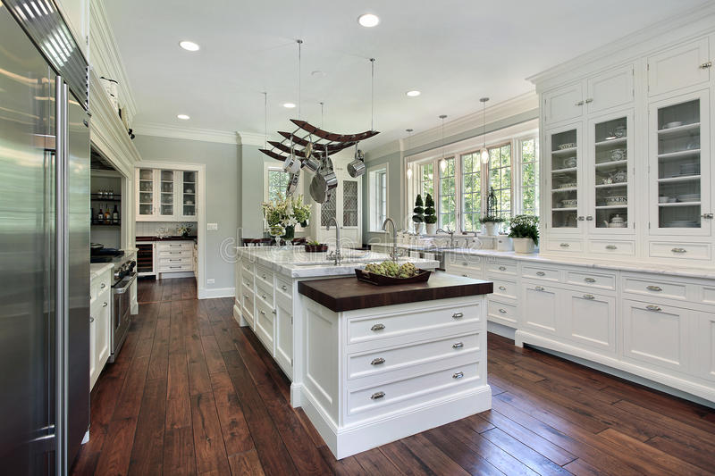 Kitchen with white cabinetry stock images
