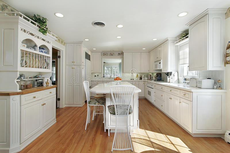 Kitchen with white island stock photography