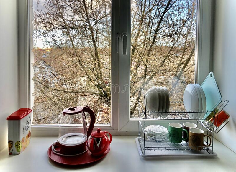 Kitchen window setup. Neat kitchenware setup in the residential house in Russia royalty free stock photography