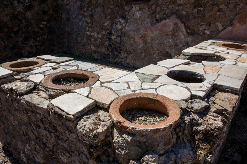 Kitchens in the houses of the ancient city of Pompeii. The kitchens in the houses of the ancient city of Pompeii royalty free stock images