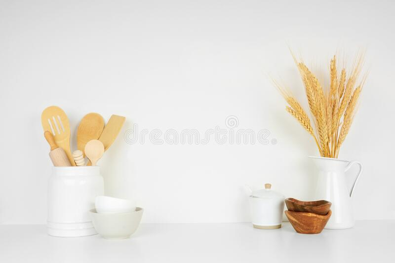 Kitchenware and utensils on a white shelf or counter against a white wall background with copy space stock images