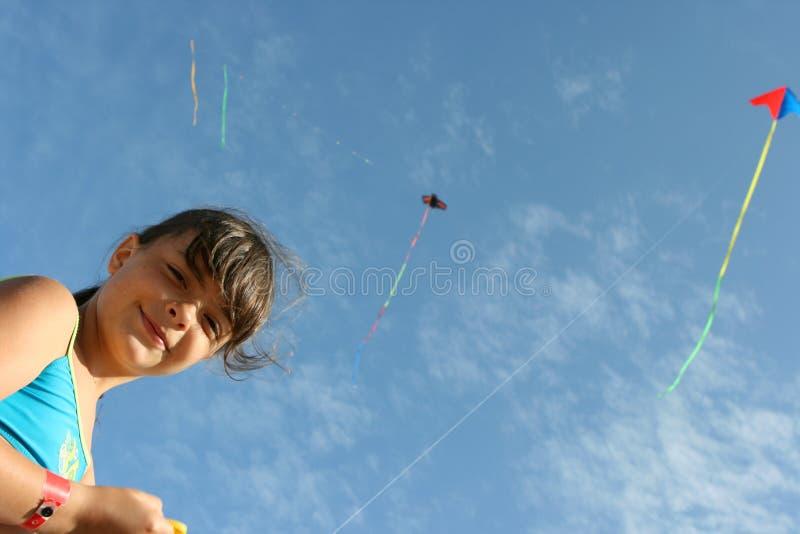 Kite. Girl flying a kite in a beach stock photos
