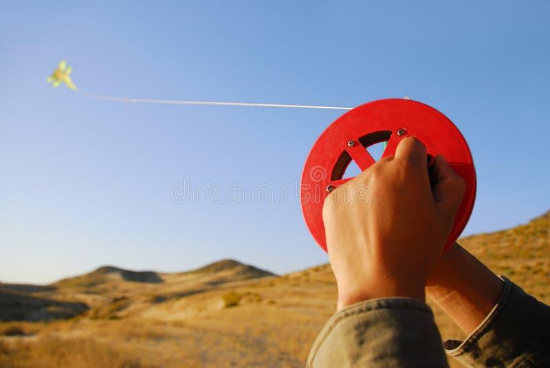 Kite. Flying a kite in desert royalty free stock image