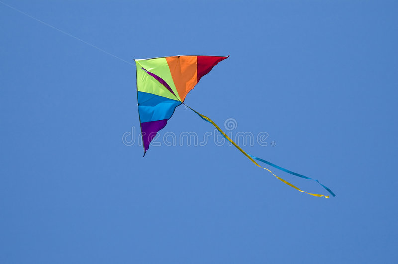Kite. Colored kite in the blue sky royalty free stock photo