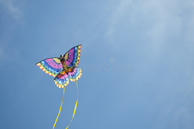 Kite arcing through the sky stock images