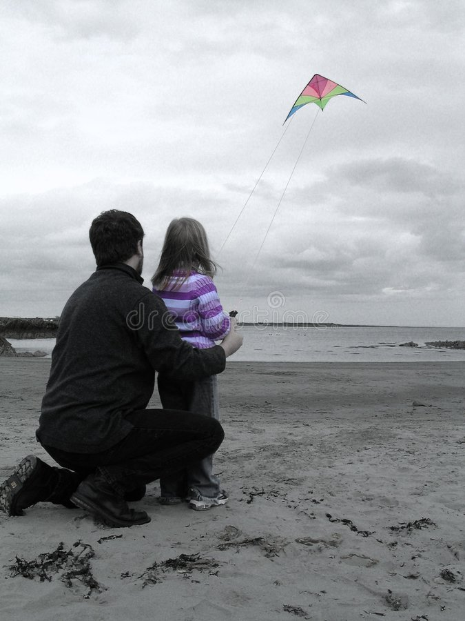 A kite and a beach royalty free stock photos