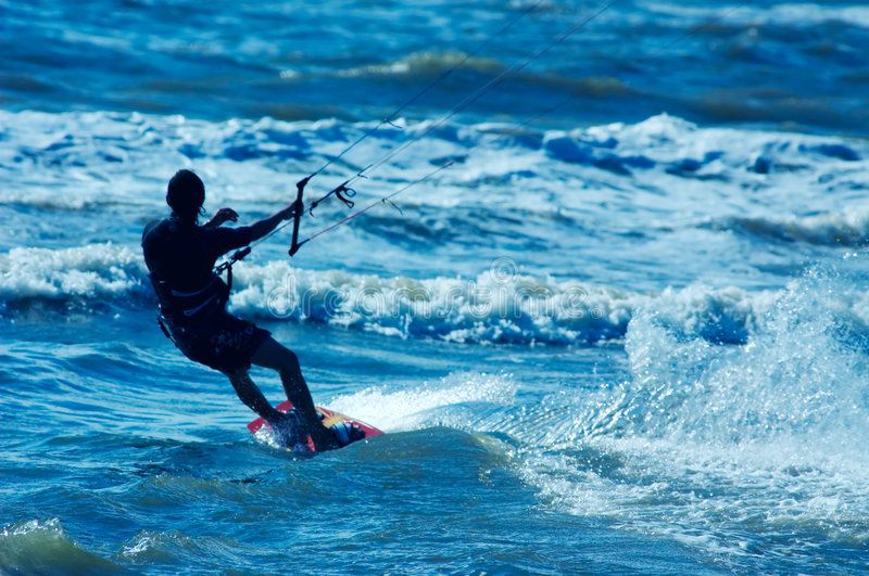 Kite boarder. Kite surfer in action royalty free stock photo