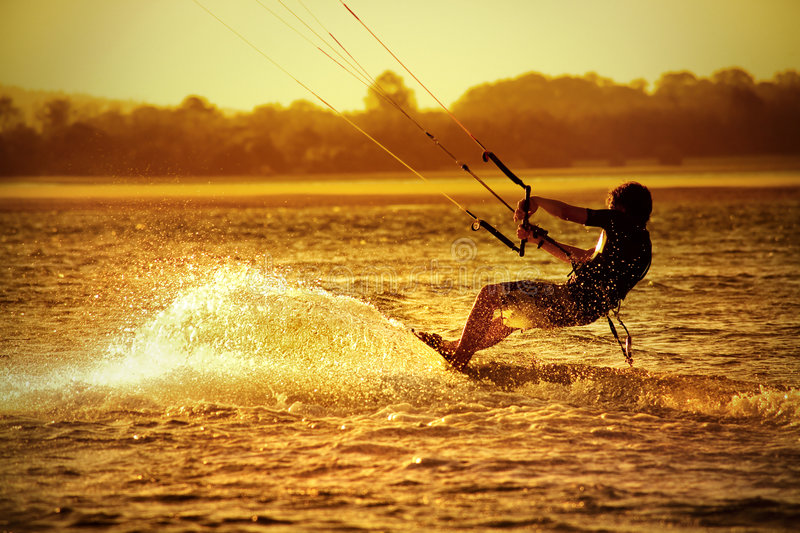 Kite boarder. On ocean at sunset - sport stock photography