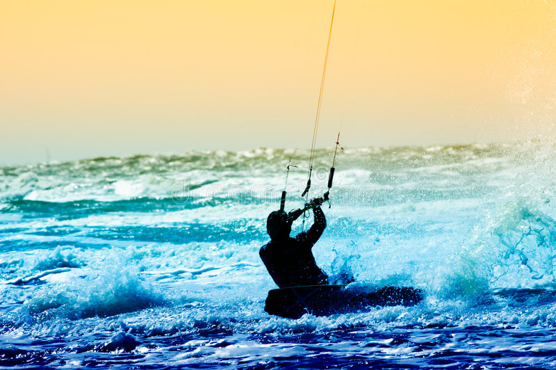 Kite boarder. Colorful image of a kite boarder in action royalty free stock photos