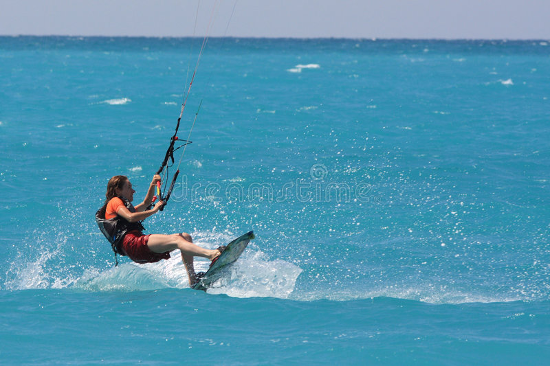 Kite boarder. Flying through the air on a sunny day stock photo
