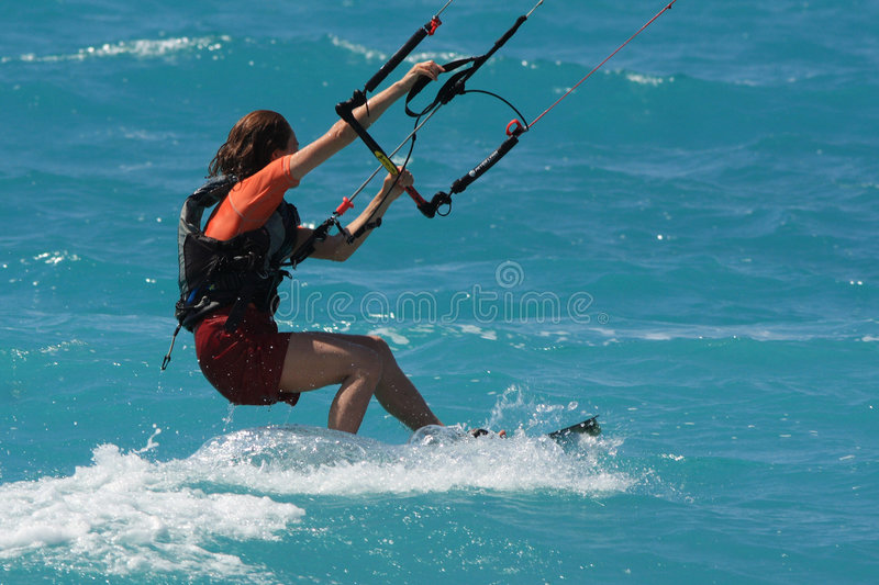 Kite boarder. Flying through the air on a sunny day royalty free stock image