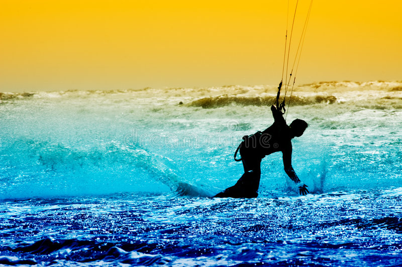 Kite boarder in action. Colorful image of a kite boarder in action royalty free stock photos