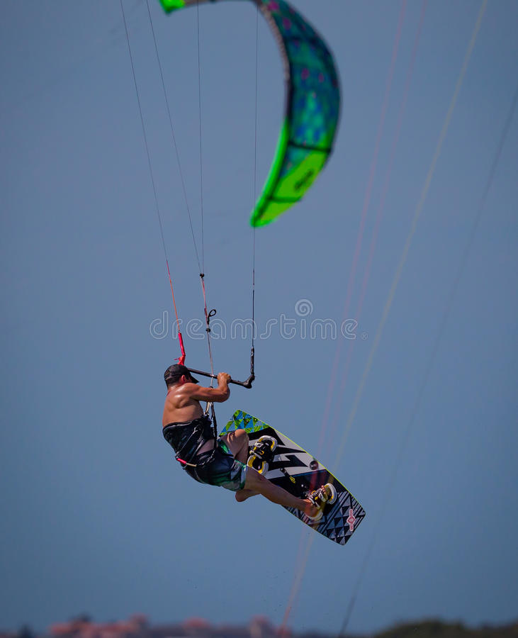 Kite Boarder in Florida flies dramatically through the sky royalty free stock photo