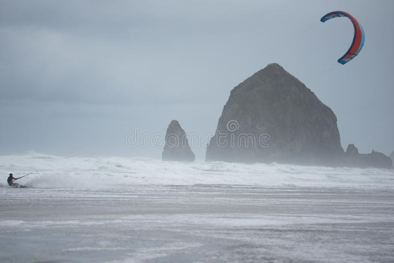 Kite boarder with sea stacks in background stock image