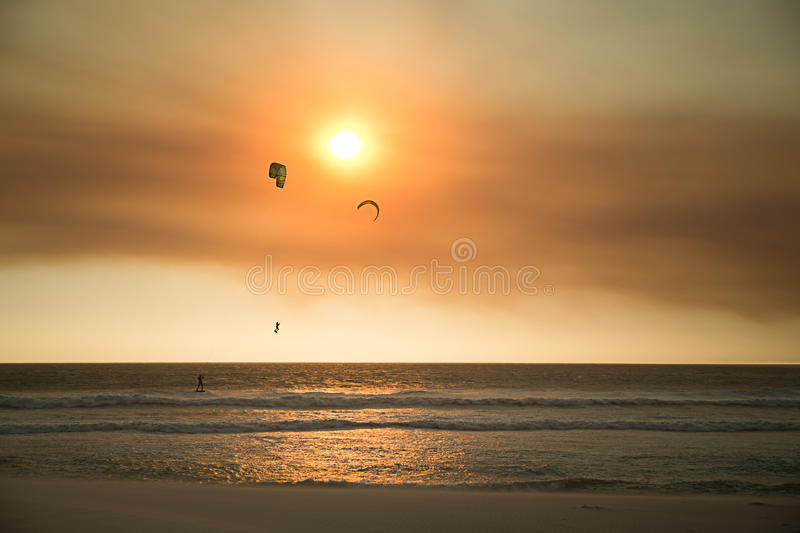 Kite Boarders. On Blouberg Beach at Sunset royalty free stock photo