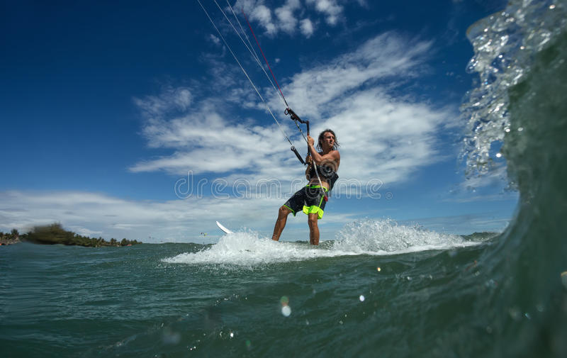 Kite boarding. Kitesurf freestyle at the sunset royalty free stock images