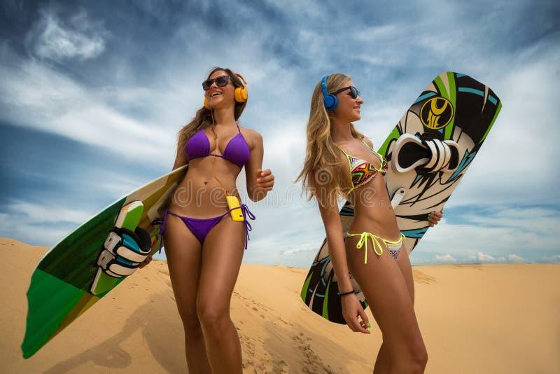 Kite boarding. Kitesurfers party freestyle at dunes stock photo
