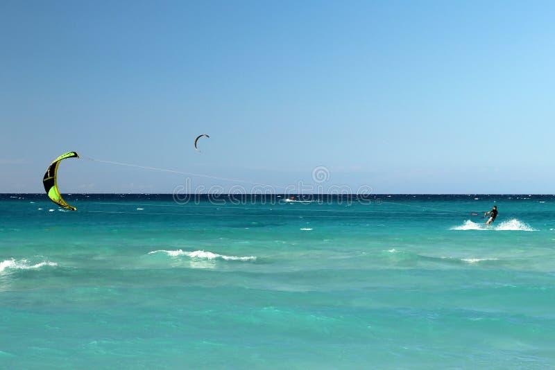 Kite boarding. Mans riding his kiteboard on Varadero beach stock photos