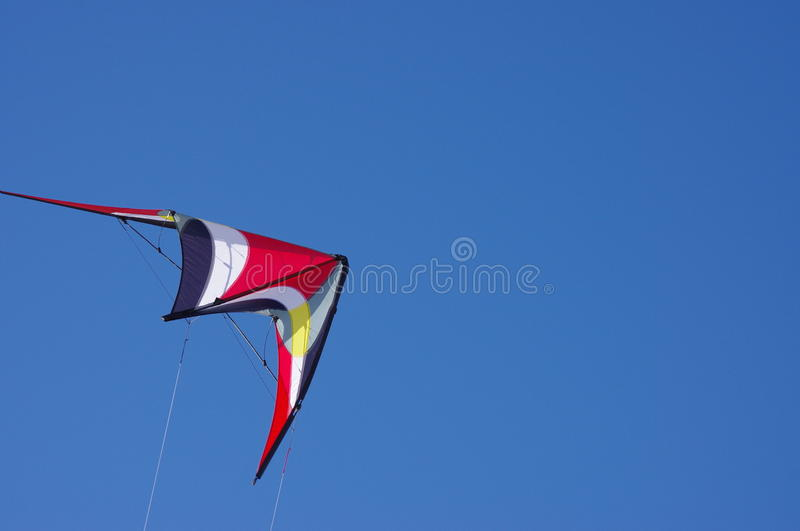 Kite in clear blue sky stock images