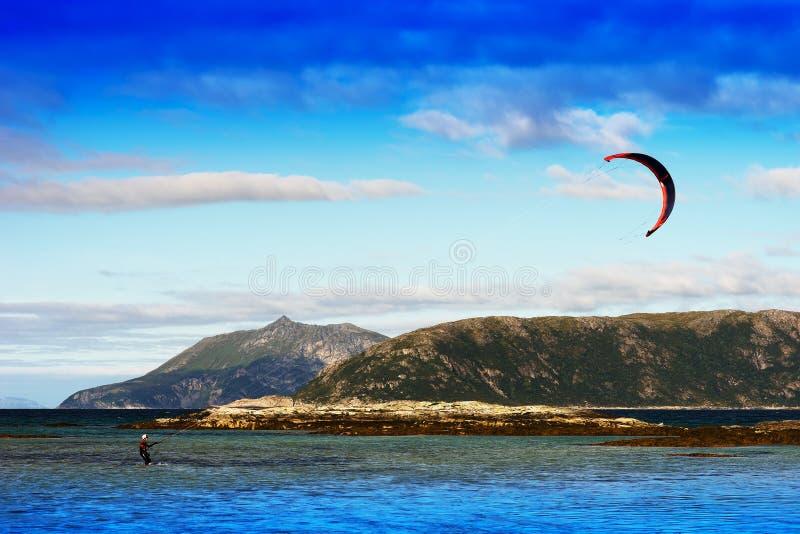 Kite flyer in sea sepia background. Hd stock photos