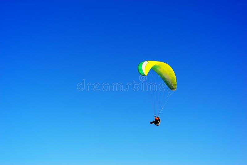Kite flyer in the sky background. Hd orientation vivid vibrant color bright rich composition design concept element object shape backdrop decoration scene stock photography