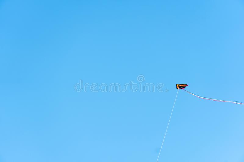 Kite flying with blue sky on background. Seattle, Washington - 2019-03-17 - Kite flying in Greenlake as Spring begins in Seattle stock image