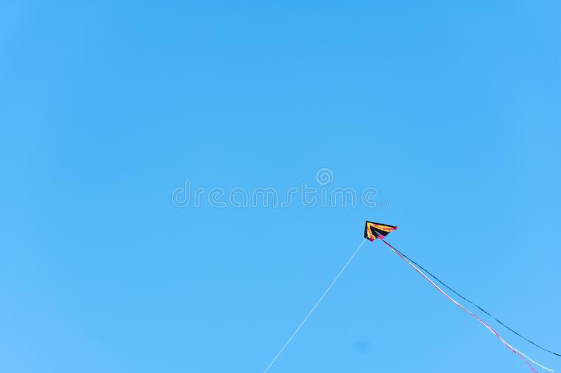 Kite flying with blue sky on background. Seattle, Washington - 2019-03-17 - Kite flying in Greenlake as Spring begins in Seattle stock images