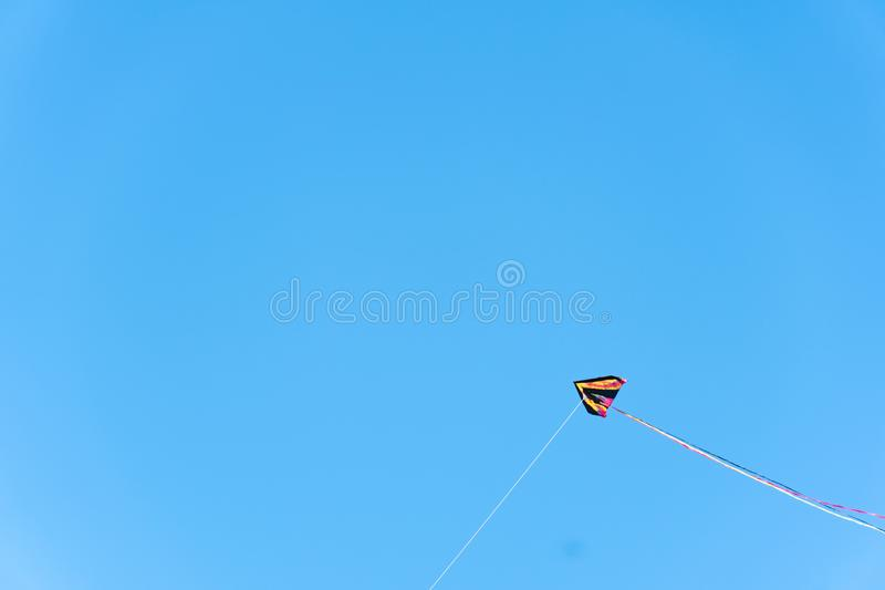 Kite flying with blue sky on background. Seattle, Washington - 2019-03-17 - Kite flying in Greenlake as Spring begins in Seattle royalty free stock image