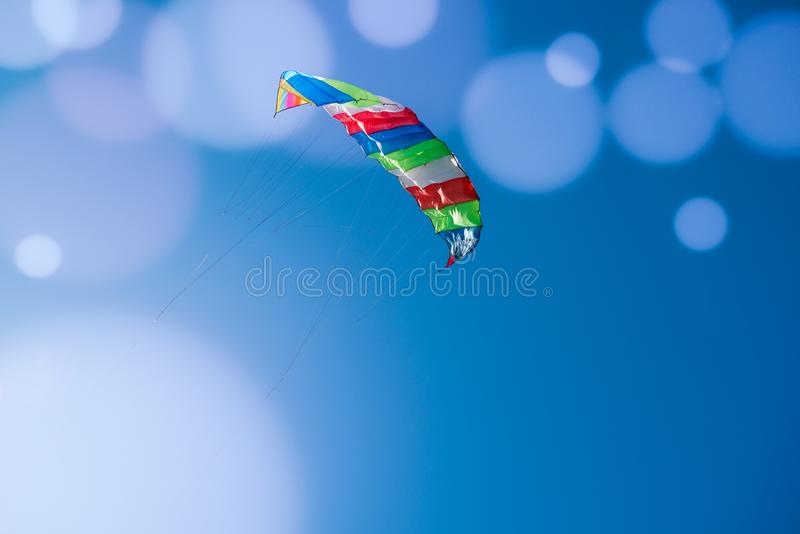 Kite flying in the blue sky, bokeh.  royalty free stock photography