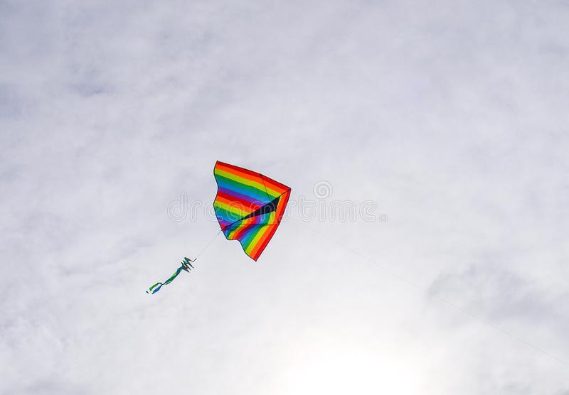 Kite Flying over Cape Hatteras National Seashore. A colorful kite flies above the waves at Cape Hatteras National Seashore in North Carolina royalty free stock photography