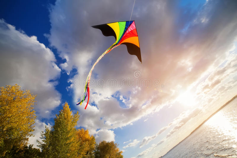 Kite flying in a sky stock image