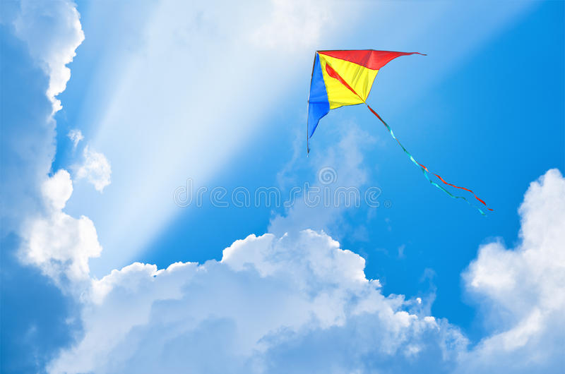 Kite flying in the sky. Among the clouds royalty free stock photos