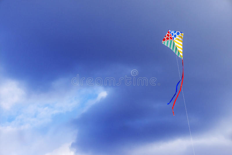 Kite flying in the sky royalty free stock photos