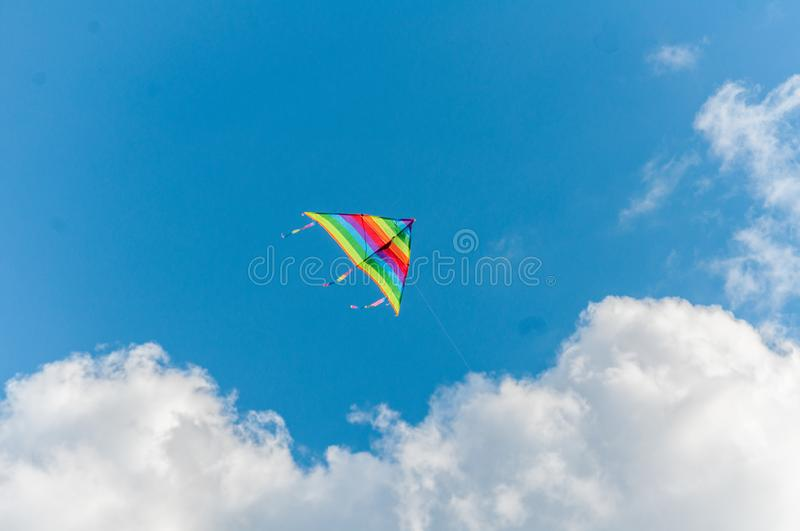 Kite flying in the sky. Couds in the background stock photography
